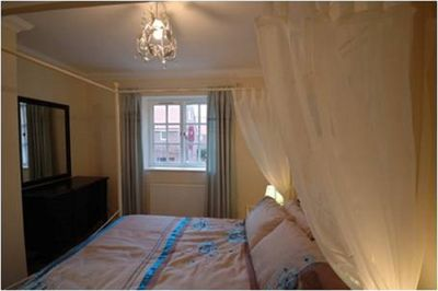 The romantic bedroom with four poster bed.
