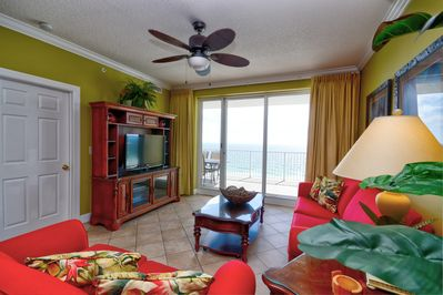 """Large living room opens to balcony, and offers 50"""" flat screen TV"""