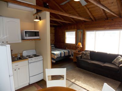 Cozy and comfortable living space in a true cabin experience.