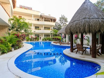 Photo for La Tortuga - Delightful abode with 2 patios one private and one poolside