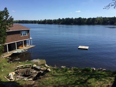 View from the cottage overlooking fire pit and floating dock