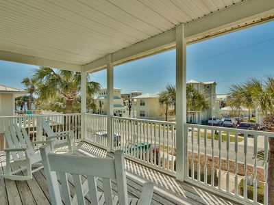 Photo for YOUR VACATION STARTS NOW! Steps to the beach! FREE Golf, Fishing & Water Park Passes
