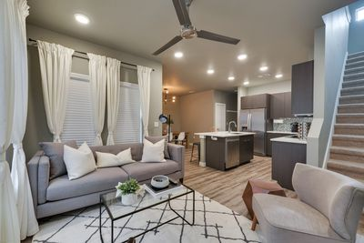Eloquently designed open living and kitchen area.