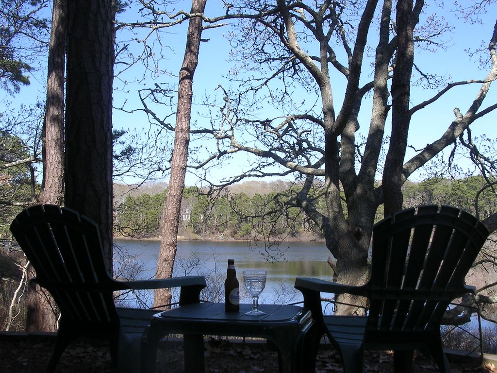 Pond front with private beach rights, dock, rowboats and swim platform.