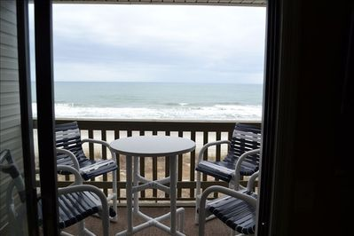 Oceanfront balcony with table and 4 bar height chairs