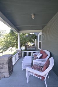Charming front porch to relax and watch the world go by!
