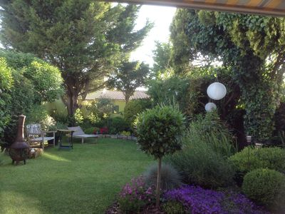 Photo for charming garden and house 4 minutes from the bridge of Ré and 4 minutes from the market la rochelle.