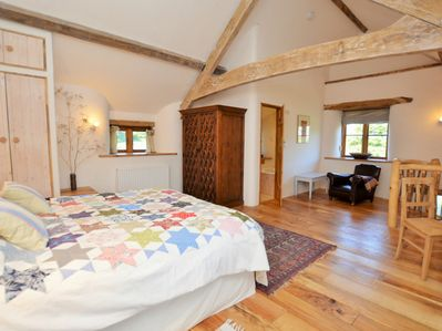 Light, bright and airy super king-size bedroom with en-suite bathroom