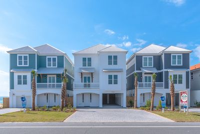 30A Away (left) sits right next to some of our other beautiful vacation homes.