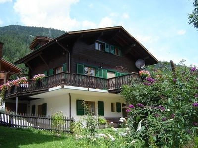 Photo for Big chalet with sauna, 3 bathrooms, walking minutes from cable car,private park.