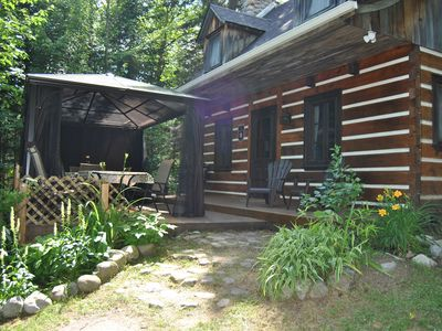 Photo for SUPERB WOOD CHALET IN A WARM AND COMFORTABLE FOREST