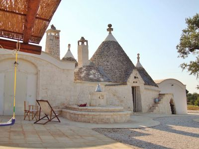 Photo for Villa of 4 conical roofs (trullo), fully renovated in big property. Sea view