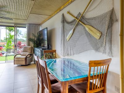 Photo for Updated tropical condo w/ shared pool & grill - great location!