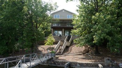 Lake front lot with elbow room and privacy; easy steps to dock and water;