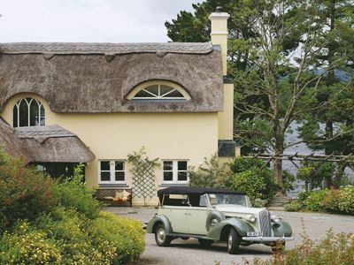 Photo for Luxury thatched cottage at five star Sheen Falls Lodge Resort