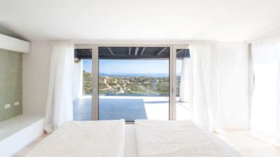 Photo for MODERN VILLA IMMERSED IN THE GREEN BREATHTAKING VIEW