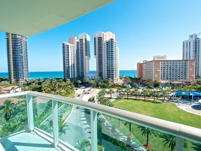 Photo for Comfortable condo w/ ocean views. WiFi, parking, tennis, playground and more!