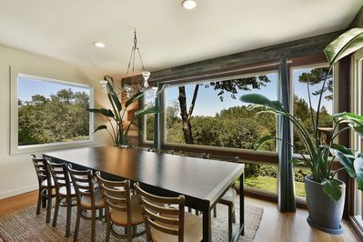 Nine foot table with Reclaimed Wood walls and Gorgeous views (seats 10-12)