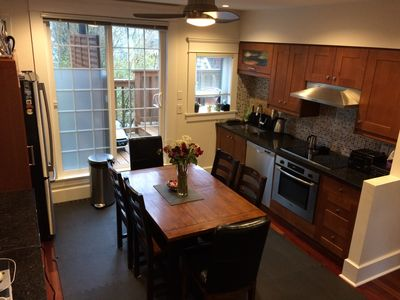 Spacious kitchen with a table that extends out for larger dinners.