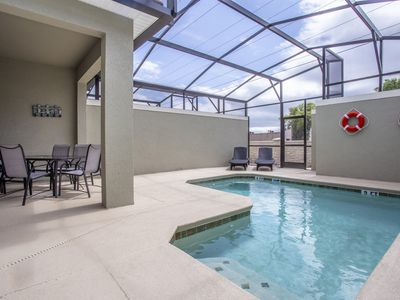 Photo for Marvelous 4 Bedroom w/ Screened Pool Close to Disney 4977