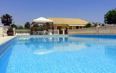 Photo for Villa with garden and swimming pool very close to the beach