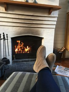 Relax in front of the wood burning fire!