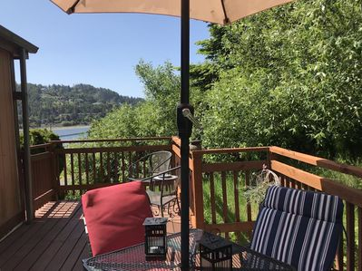 Back deck leads to a small, enclosed, private outdoor area for your use.