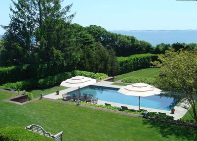 Birdseye view of the property and pool looking toward the bay.