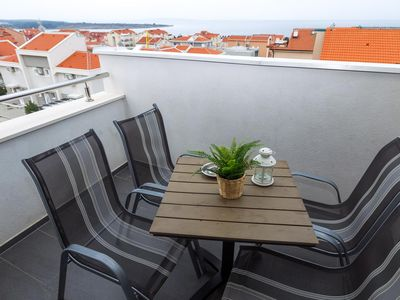 Photo for Two bedroom apartment with terrace and sea view Novalja, Pag (A-17221-j)