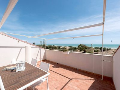 Photo for Sea View apartment, only 30 meters from the beach, with shared pool, wi-fi and parking.