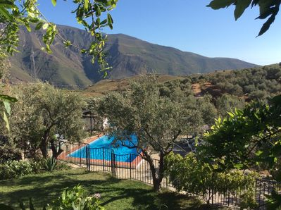 View to the pool and mountains from the Wisteria terrace