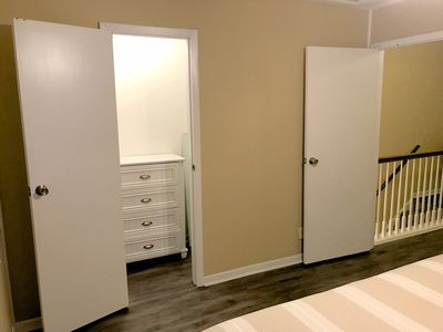Walk in closet in king bedroom