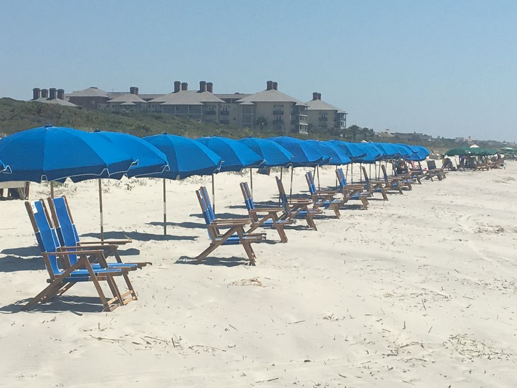View Of Beach And Chairs That Can Be Ed Through Resort