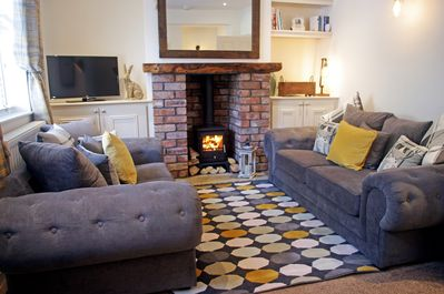 Cosy living room with log burner and brick fireplace