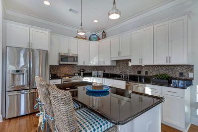 Fully Stocked Kitchen with Stainless Steal Appliances