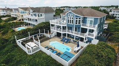Photo for OCEANFRONT Corolla-11 BDRM(8 Mstrs)Pool, Fire Pit, Steps to beach, beautiful!