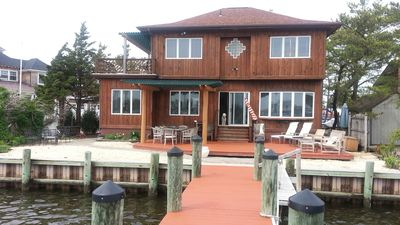 Photo for Fabulous bayfront view with 60 ft long dock fits 3 large boats
