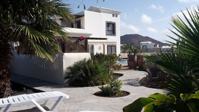 Photo for Tranquill setting, sea views, heated pool, large terraces & garden