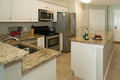 Well Stocked Upgraded Kitchen with Stainless Appliances and Granite Countertops