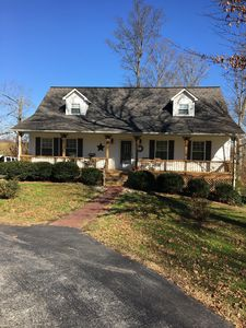 Beautiful four bedroom, 2 1/2 bath, 2 large porches with pool on 3 1/2 acres