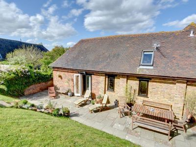 Photo for Converted barn with excellent wooden beams, high ceiling and a cosy terrace