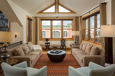 Spacious living area with mountain views, open to dining and kitchen area