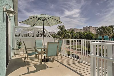 Sit outside on the spacious balcony enjoying the ocean breeze and views.