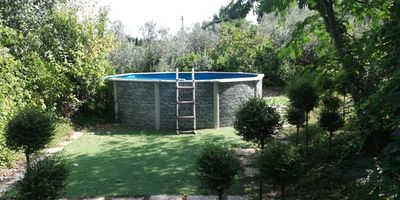 Photo for Cottage surrounded by greenery with swimming pool