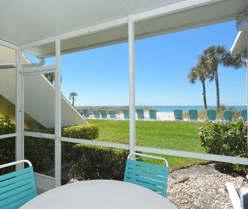 Photo for Beach front! Just a few steps to the white sand and the turquoise Gulf of Mexico.