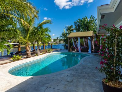 Photo for Blue Marlin 4BR waterfront home w heated pool and spa