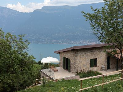 Photo for Natural stone house with breathtaking lake view