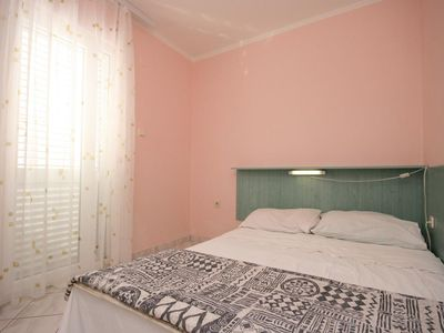 Photo for Two bedroom apartment with balcony and sea view Stara Novalja, Pag (A-6319-d)