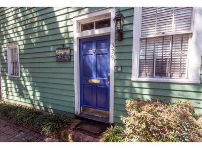 A bright front door welcomes you.