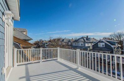 Relax on the sprawling deck with views of the beach and many shops/restaurants.
